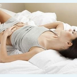 Коричневые месячные со сгустками: причины и лечение
